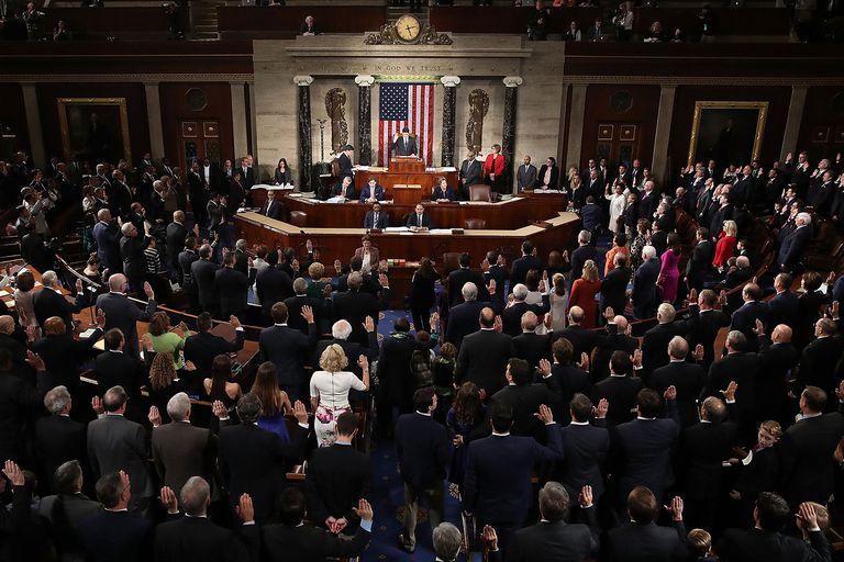 Members of Congress being sworn into office.