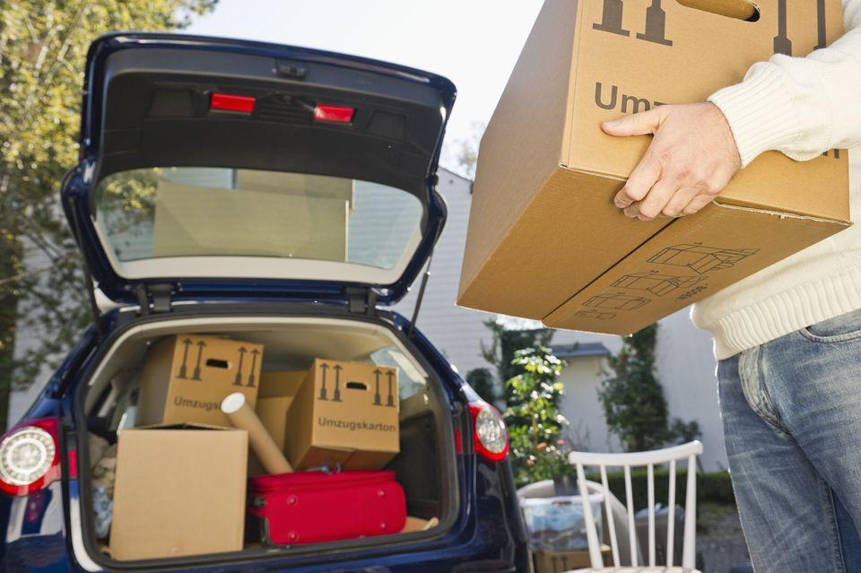 Man holding cardboard box moving