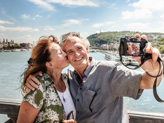 Older couple taking self portraits