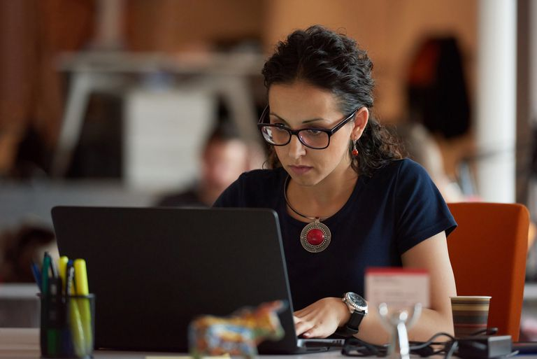 Woman programmer working in hip office