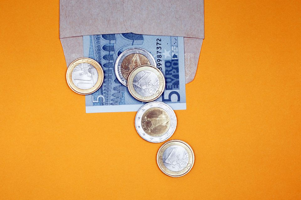 coins in a paper envelope