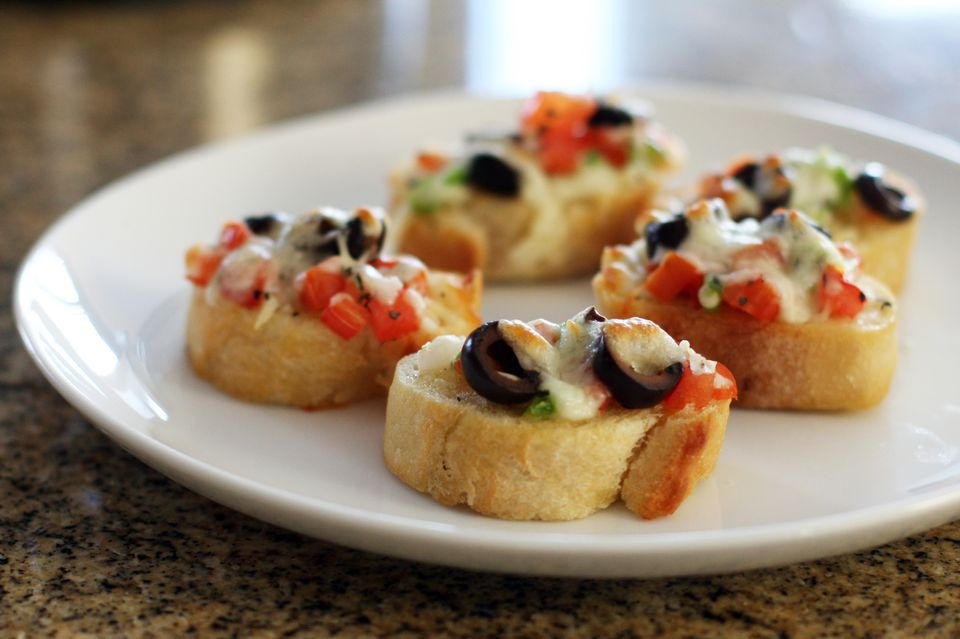 pizza crostini with pepperoni and cheese