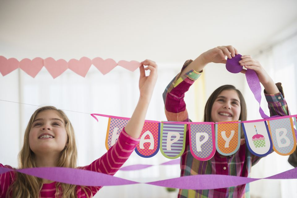 Ways to save money on birthday parties - girls decorating for party