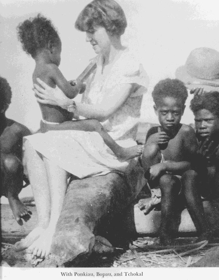 Margaret Mead with children of Manus Island, circa 1930s.