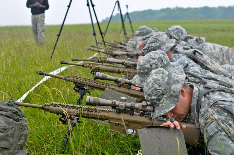 Students at the Army Sniper School practice approaching a target without being detected.