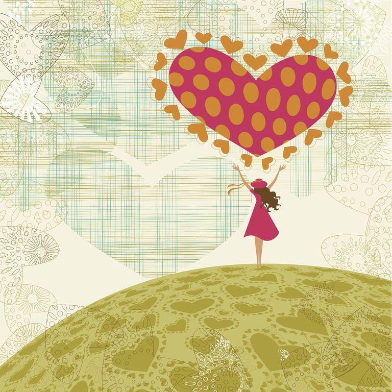Little girl holding a big heart