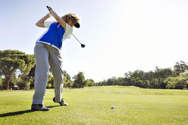Female Golfer Driving Golf Ball