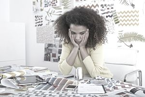 Woman working on not being miserable at work.