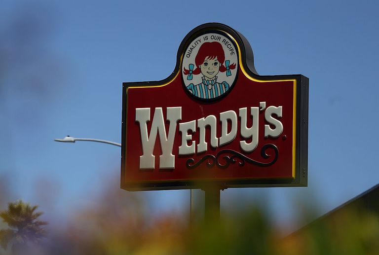 A sign is posted in front of a Wendy's restaurant on August 10, 2016 in Daly City, California