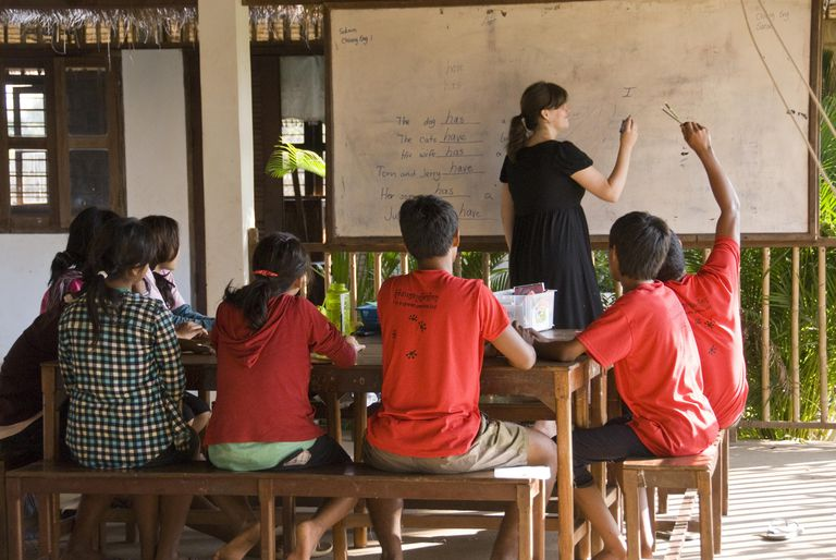 Volunteer teacher leading English class at an initiative that benefits the lives of street children.