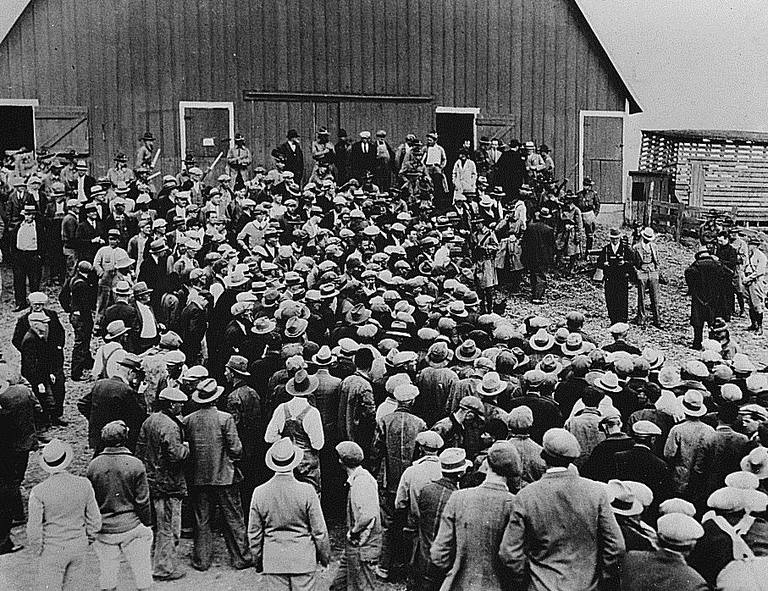 Foreclosure was common during the Great Depression. Here was a foreclosure sale in Iowa in the early 1930s. Military police were on hand to keep farmers from preventing the auction. The Home Owners Loan Corporation (HOLC) was created to help deal with this crisis.
