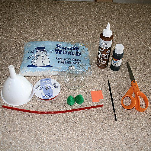 Gathering The Supplies to Make a Glass Ball Snowman