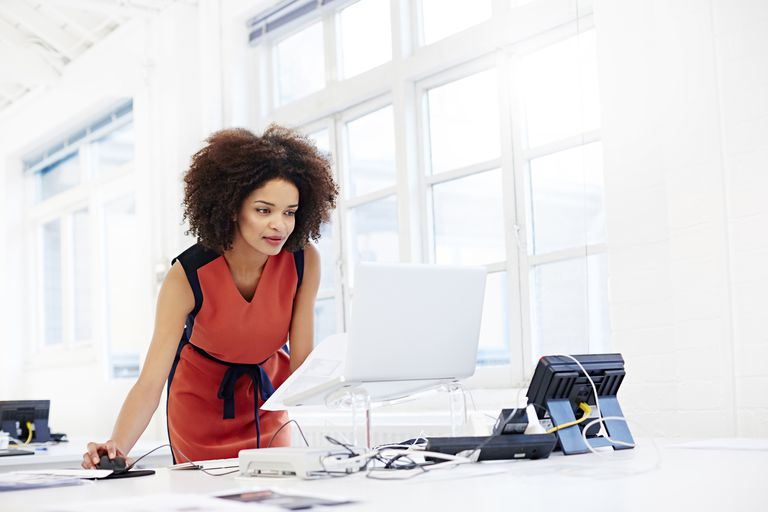 Creative woman working in open plan office.