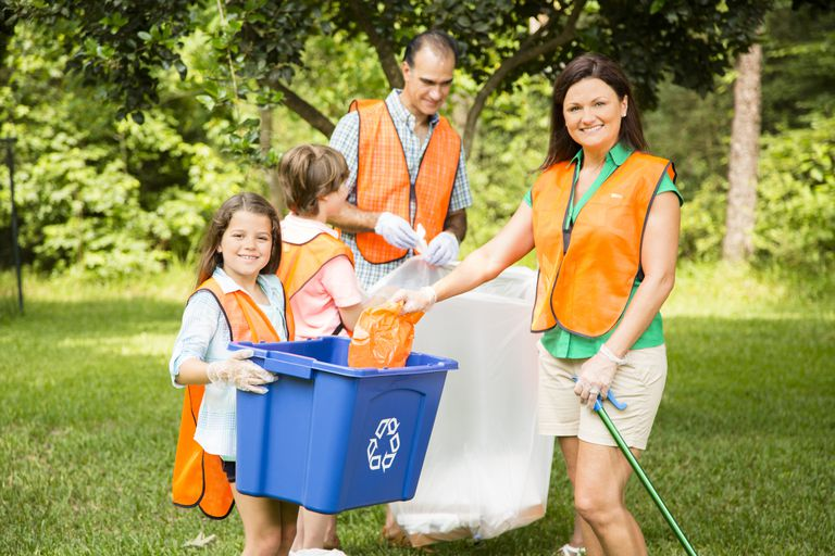 A family doing a good deed like cleaning up the park.