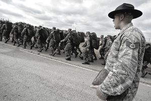 Staff Sergeant Robert George, a military training instructor at Lackland Air Force Base in San Antonio, Texas, marches his flight following the issuance of uniforms and gear. Recruits are molded into warrior Airmen through a recently expanded Air Force Basic Military Training program.