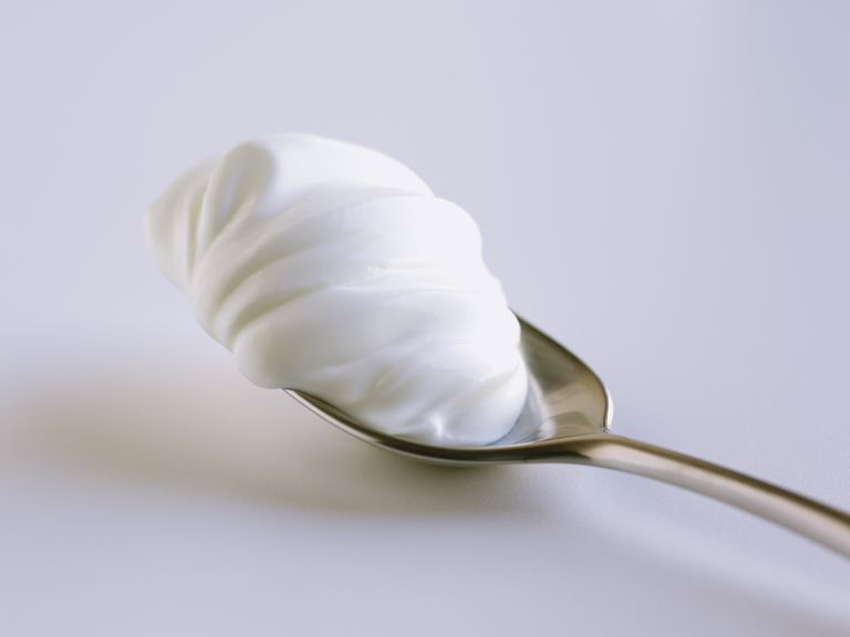 Sour cream on spoon