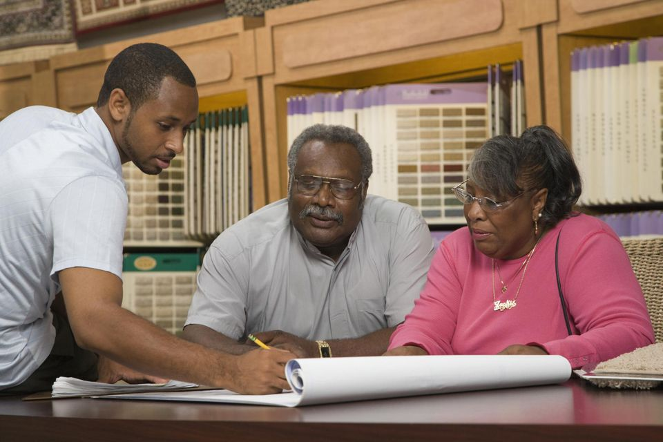 African American couple in flooring store