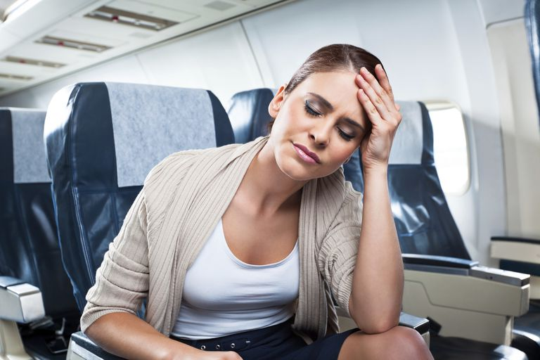 Ear pain caused by barometric pressure changes on an airplane.