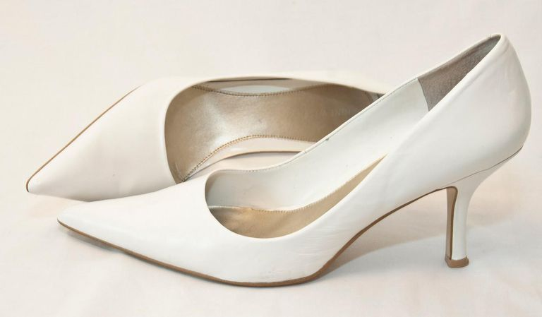 The height, shape & placement of the heel on these Nine West pumps makes them kitten heels.