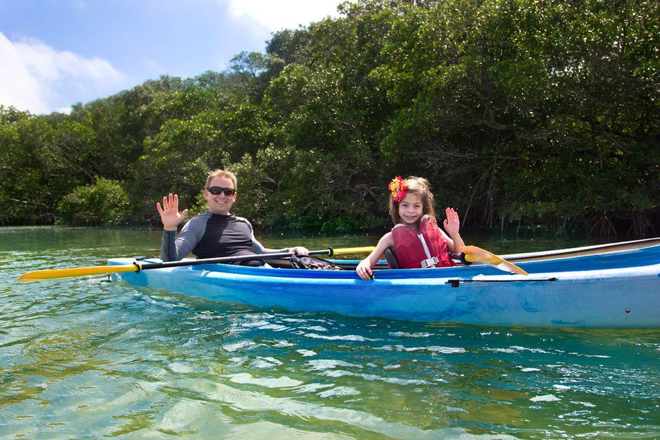 Family kayaking in Florida lake