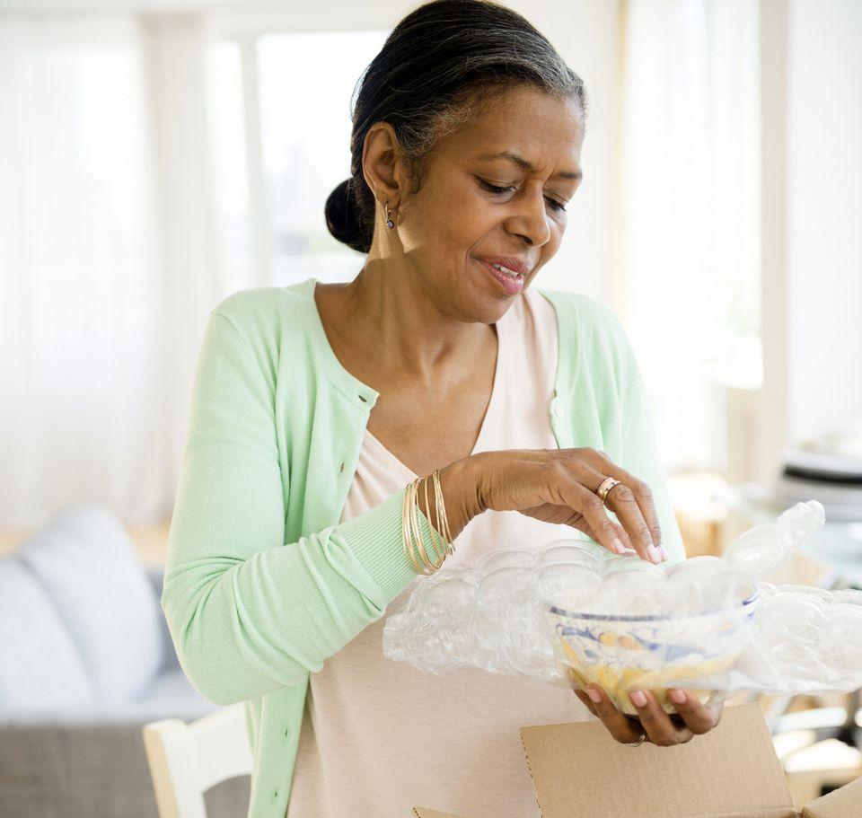 Woman Unpacking pretty bowl