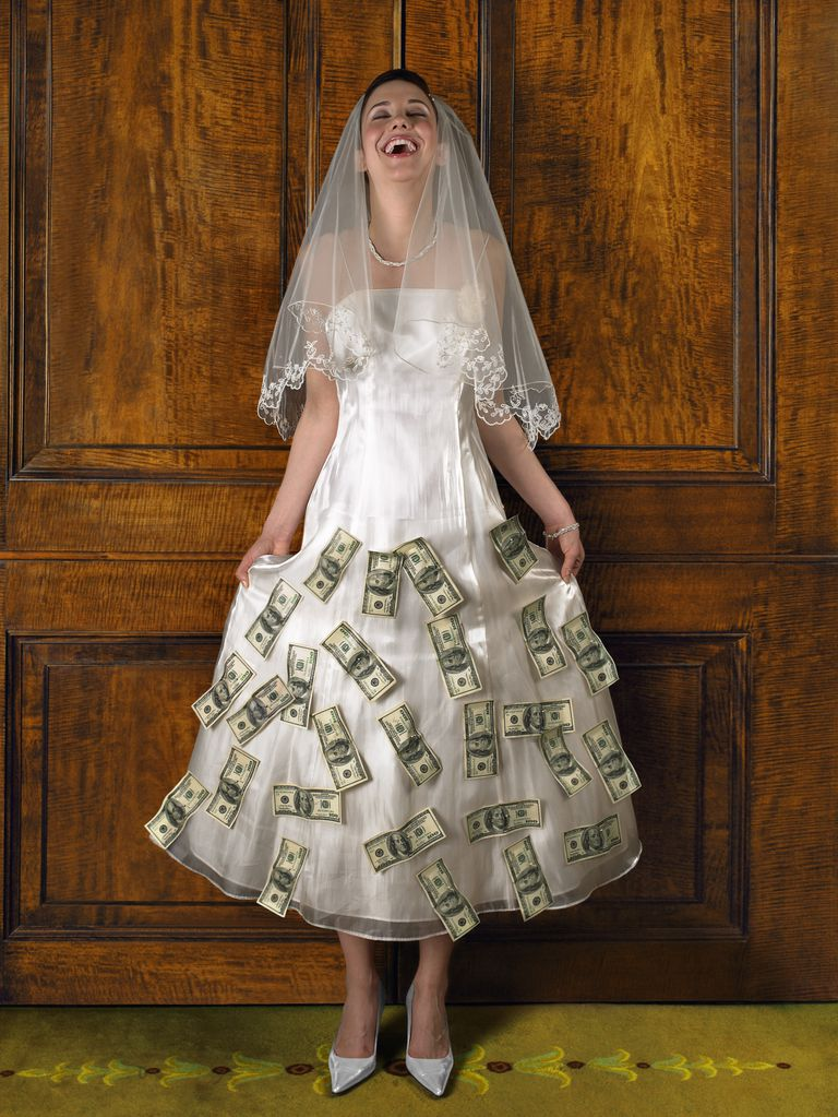 Young bride with money attached to dress.