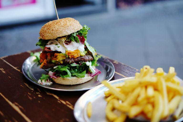 Close-Up Of Large Hamburger On Table