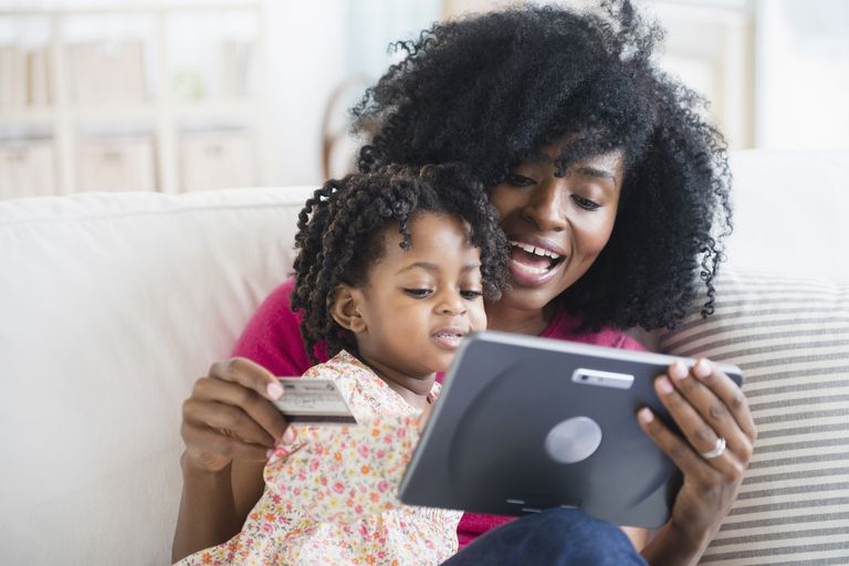 Mother and daughter shopping on tablet computer