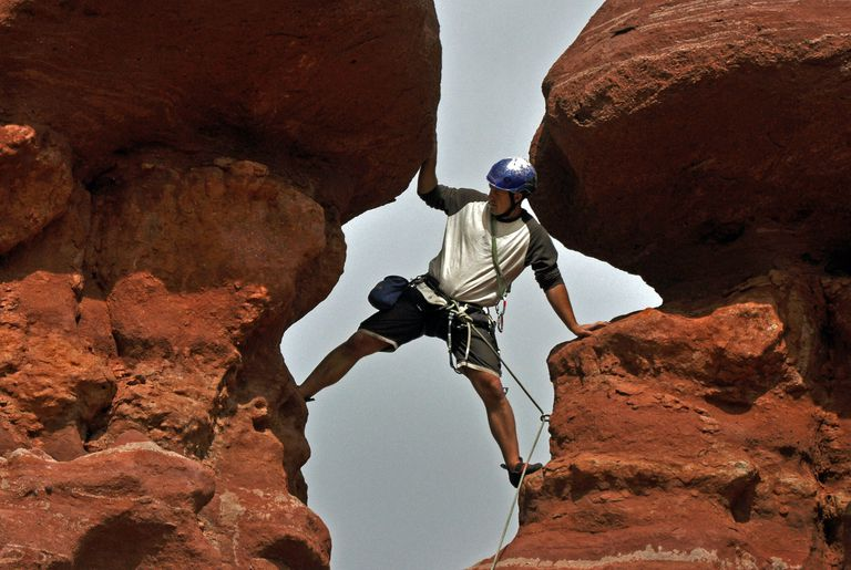 Brian Shelton with Front Range Climbing Company climbs a chimney on Carson's Tower in the Fisher Towers in Utah.
