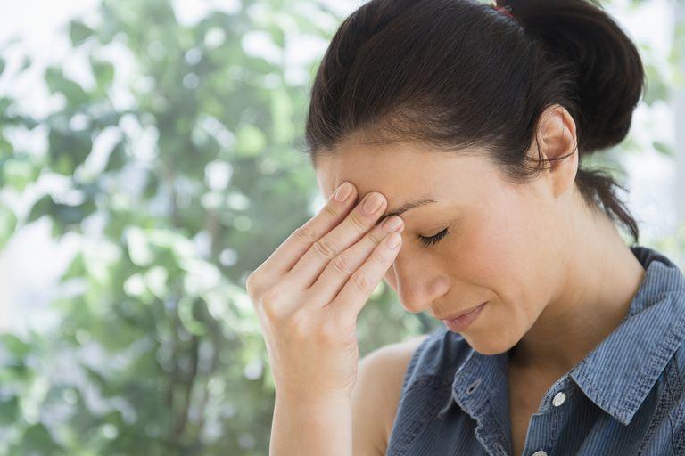Suffering from a migraine headache.