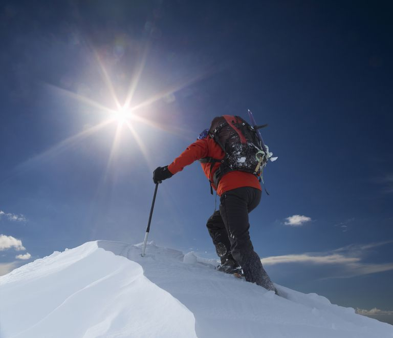 Man climbing snowy mountain