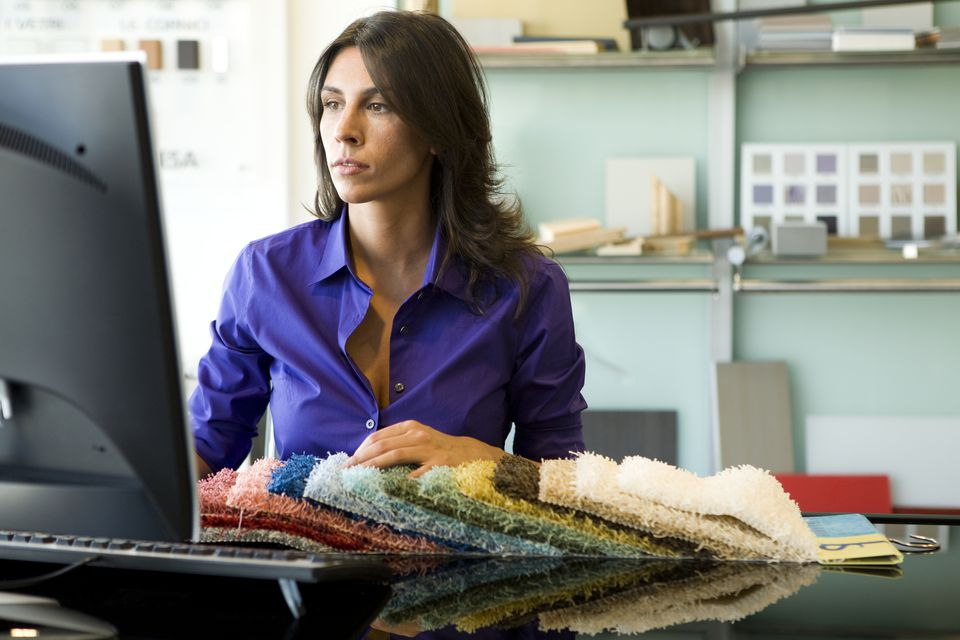 Woman researching carpet on computer