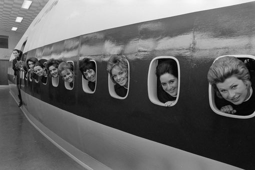 Figure 1-1: A picture of a dozen women looking out of a dozen airplane windows.
