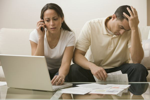 Man and woman stressed out about bills