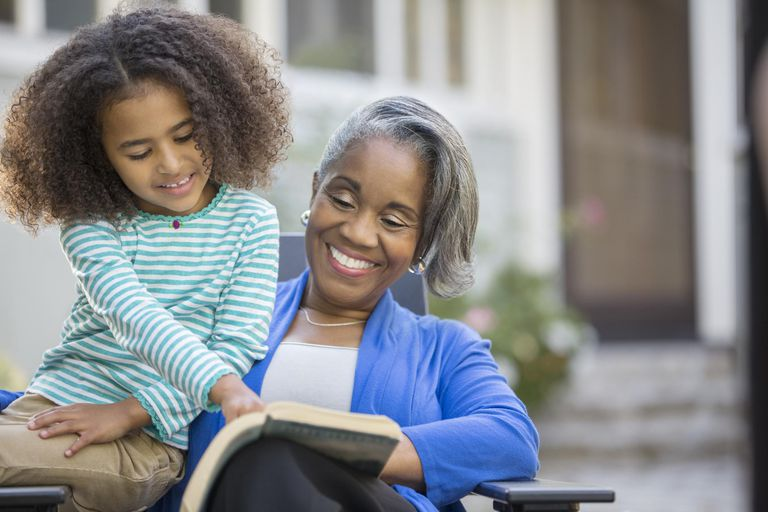 Grandmother With Granddaughter Learning to Read