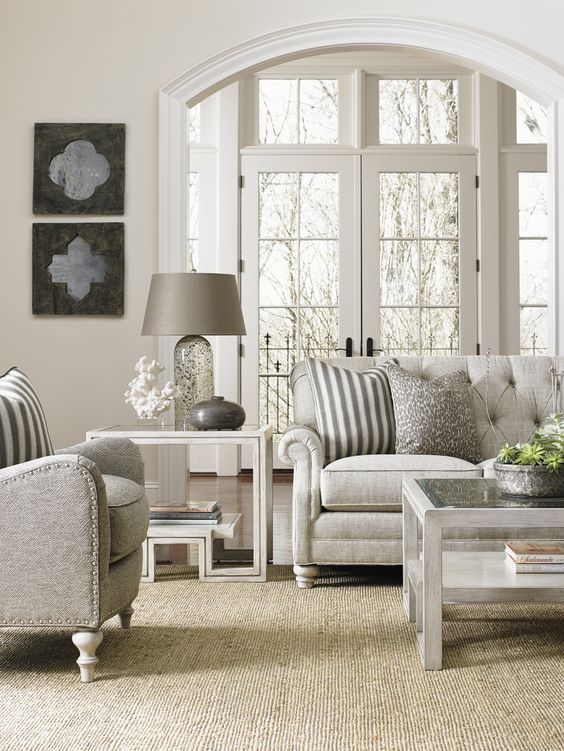 A living room decorated in silvers and grays
