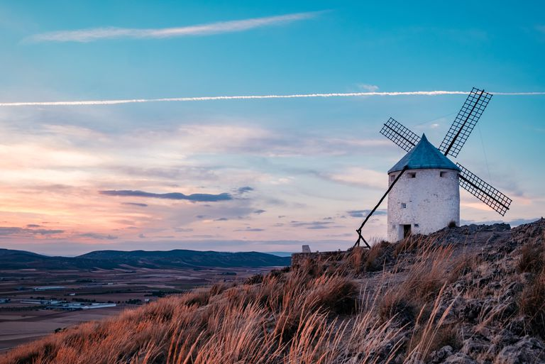 Windmills at the sunset in Consuegra town in Spain