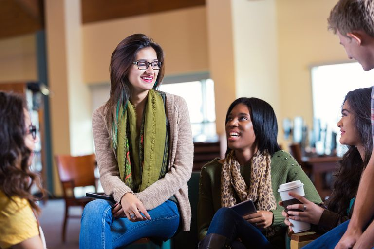 Diverse college students meeting in library or coffee shop