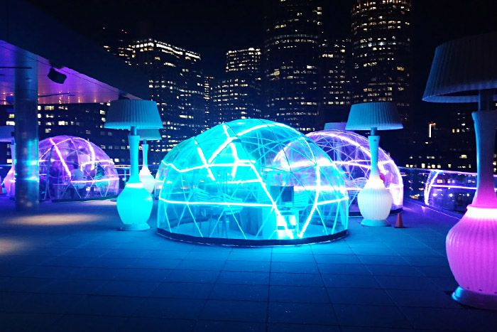 Heated igloo at the The Envoy's hotspot Lookout Rooftop & Bar in Boston.