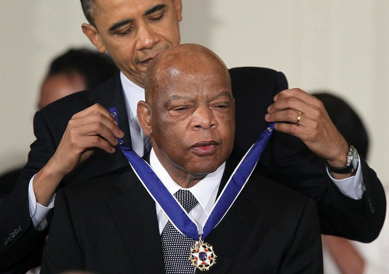 ASHINGTON, DC - FEBRUARY 15: U.S. Rep. John Lewis (D-GA) (R) is presented with the 2010 Medal of Freedom by President Barack Obama during an East Room event at the White House