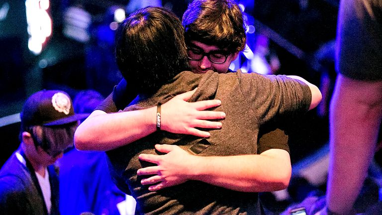 Two gamers hugging in purple Twitch light