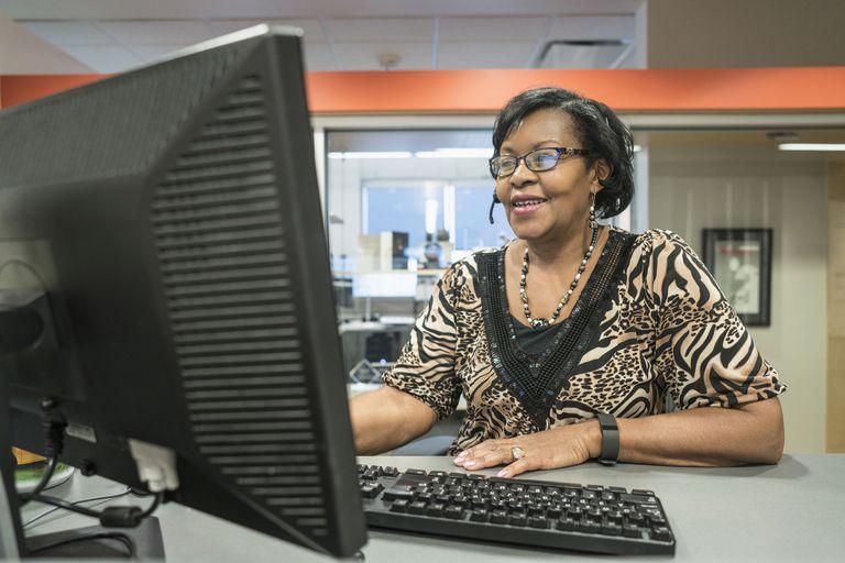 Black receptionist working in office