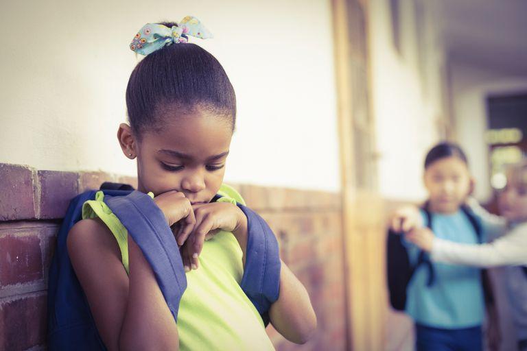 sad girl being bullied in hallway