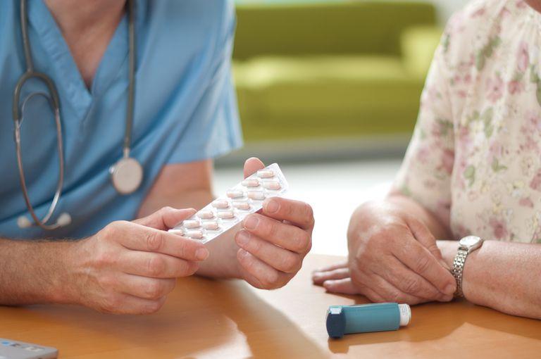 A doctor holding a patient's prescription.
