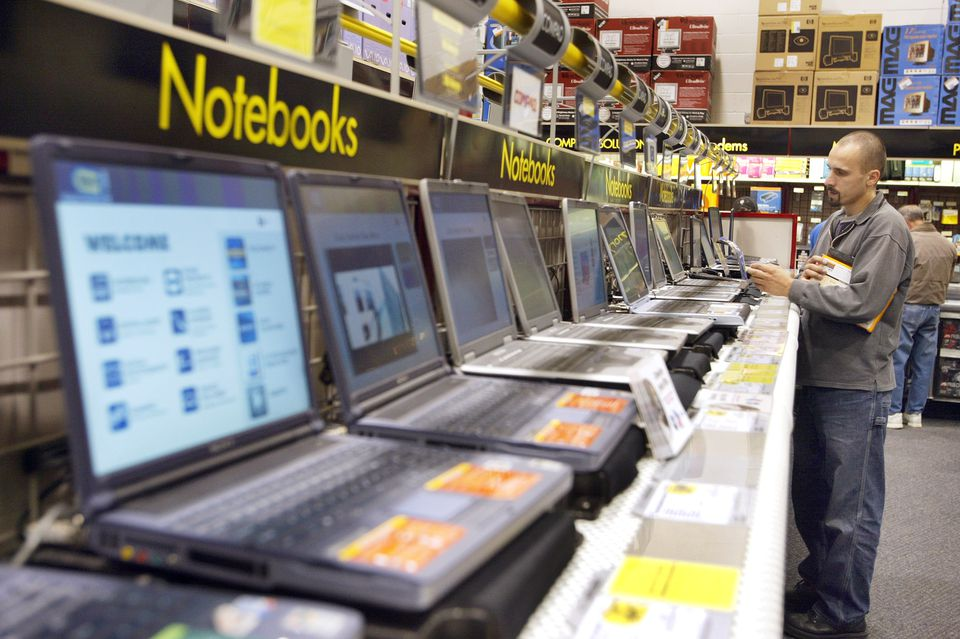 Shopper looks at notebook computers at Best Buy