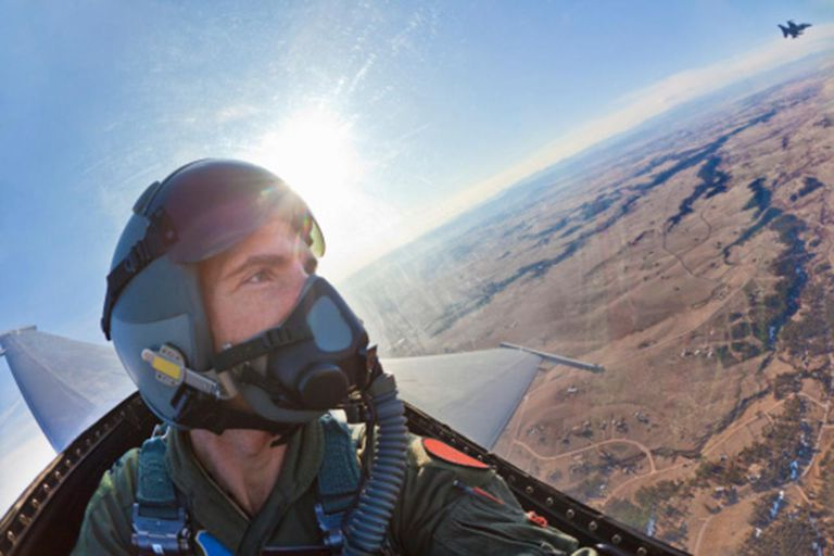 Front view of fighter pilot flying in F-16.