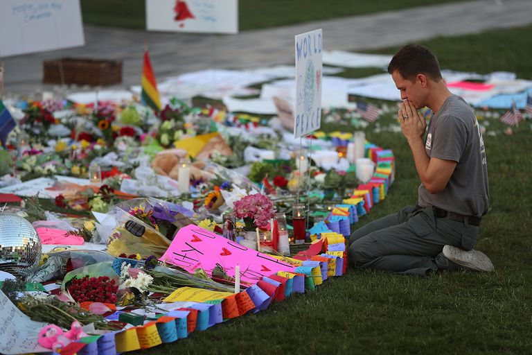 A man prays before a memorial to the victims of the Pulse nightclub mass shooting in Orlando, Florida. Mass shootings in the U.S. have been on the rise for decades.