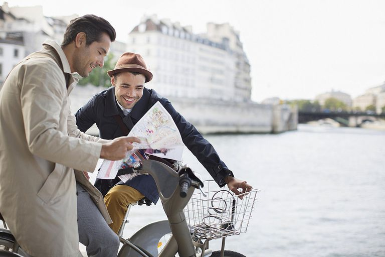 Men looking at map along Seine River, Paris, France