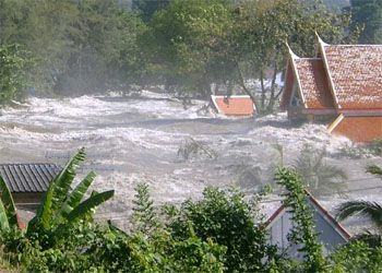 One of the South Asian tsunami waves innundates a town in Indonesia, 2004.