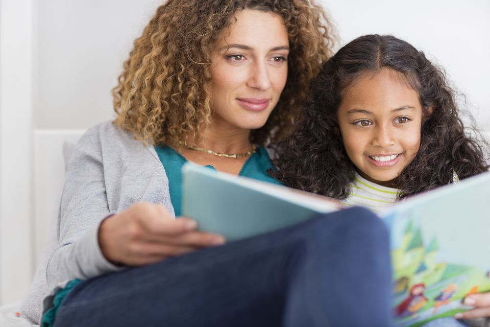 Mom and daughter reading a book.